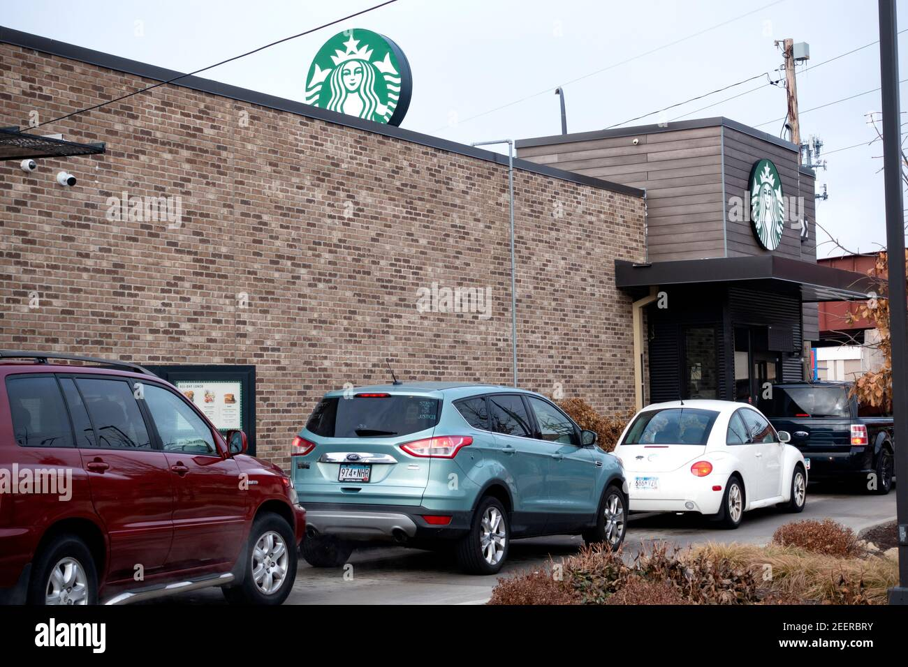 Cars in line at the Starbucks Drive-Thru during the Covid Pandemic. St Paul Minnesota MN USA Stock Photo