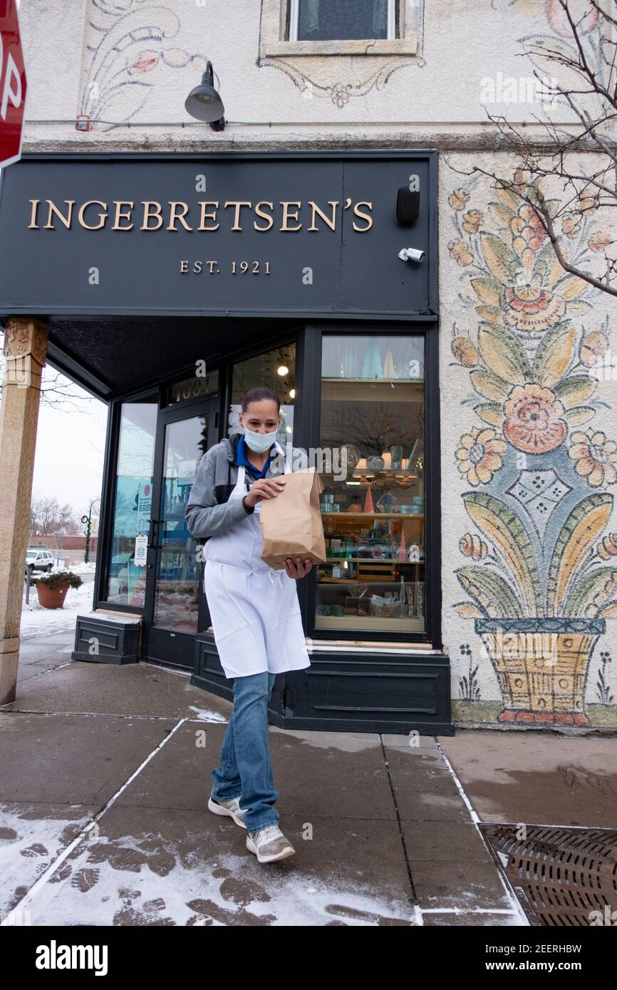 Curbside order with masked delivery of lutefisk from the Ingebretsen's Nordic Market Place during Covid Pandemic. Minneapolis Minnesota MN USA Stock Photo