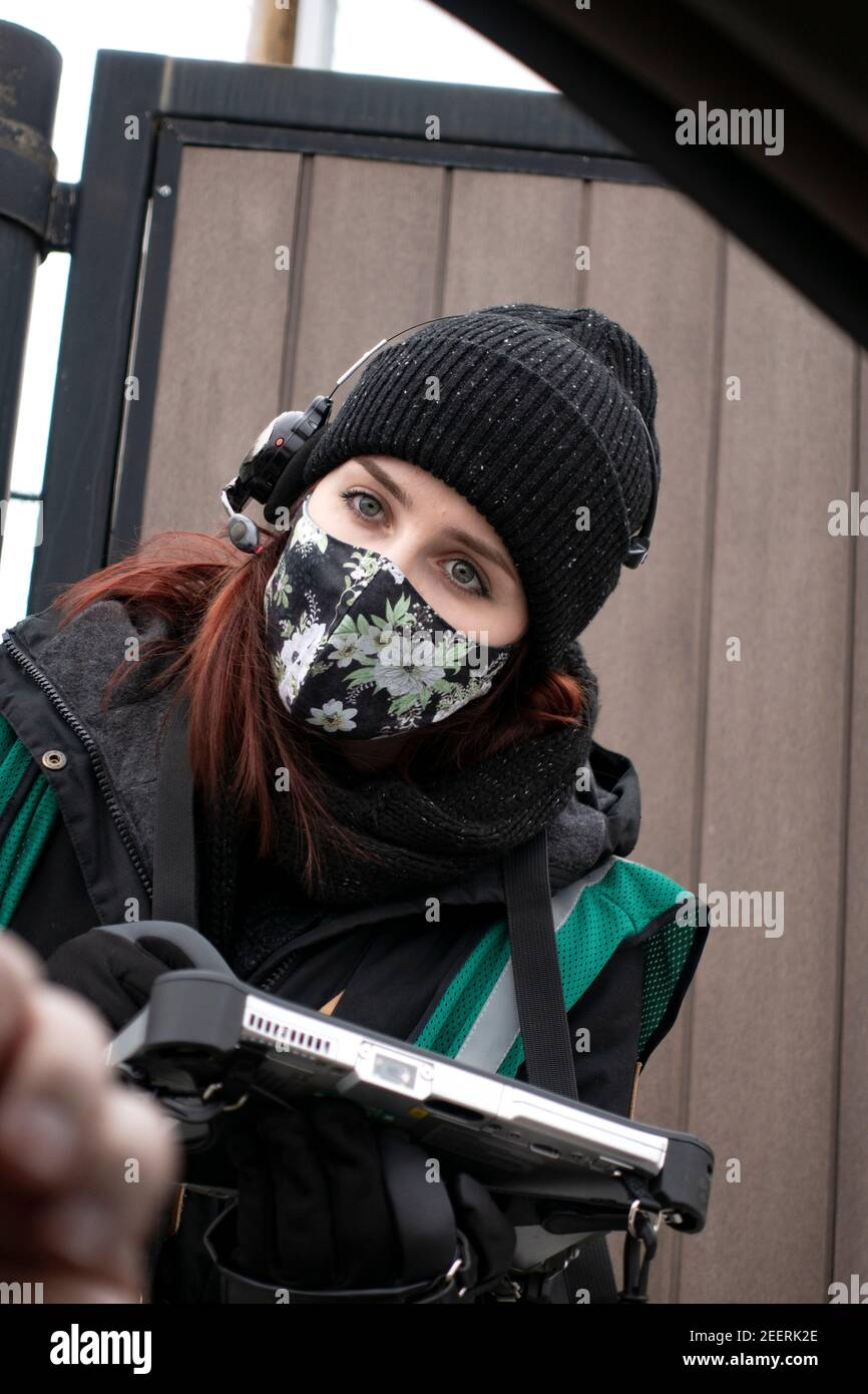 Starbucks barista taking coffee order curbside with mask at the drive-thru. St Paul Minnesota MN USA Stock Photo
