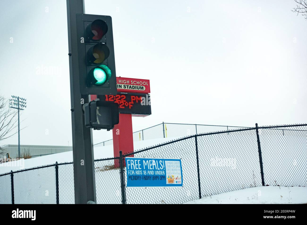 Sign on fence near semaphore advertising free meals for kids under 18 at Central High School. St Paul Minnesota MN USA Stock Photo