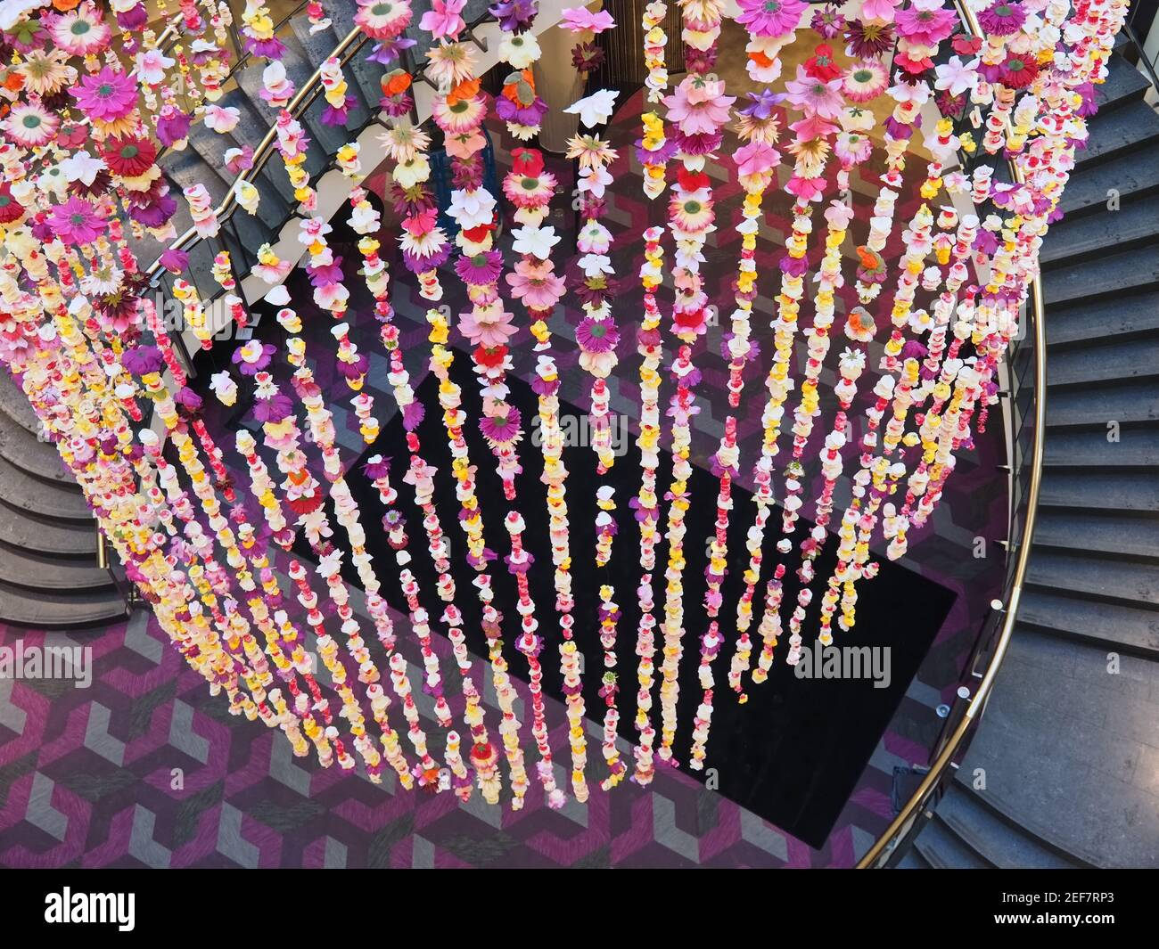 Stairway with flower decoration Inside the famous mall Schadow Arkaden in Duesseldorf Stock Photo