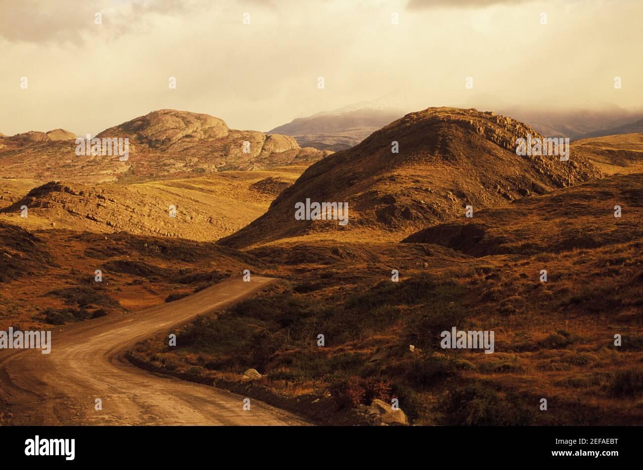 Dirt road through a landscape Stock Photo
