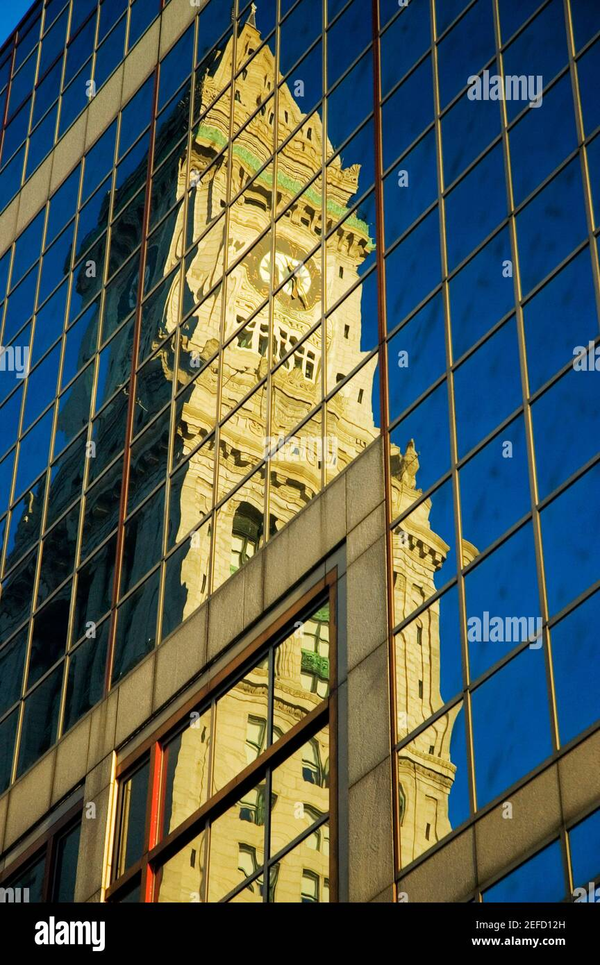 Low angle view of the reflection of a tower on the glass front of a building, Custom House, Boston, Massachusetts, USA Stock Photo