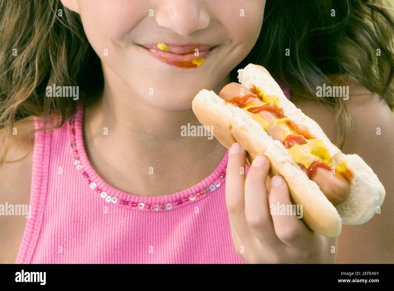 Close-up of a girl eating a hot dog Stock Photo