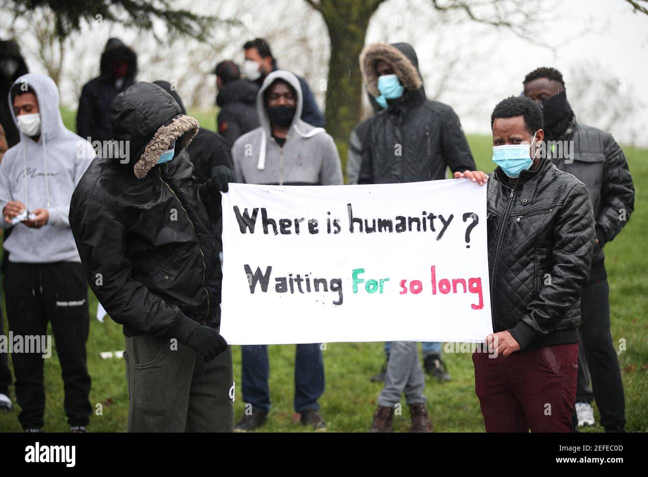 Protesters outside the Crowne Plaza London Heathrow hotel in West Drayton, London, which is being used as accommodation for asylum seekers. Picture date: Wednesday February 17, 2021. Stock Photo