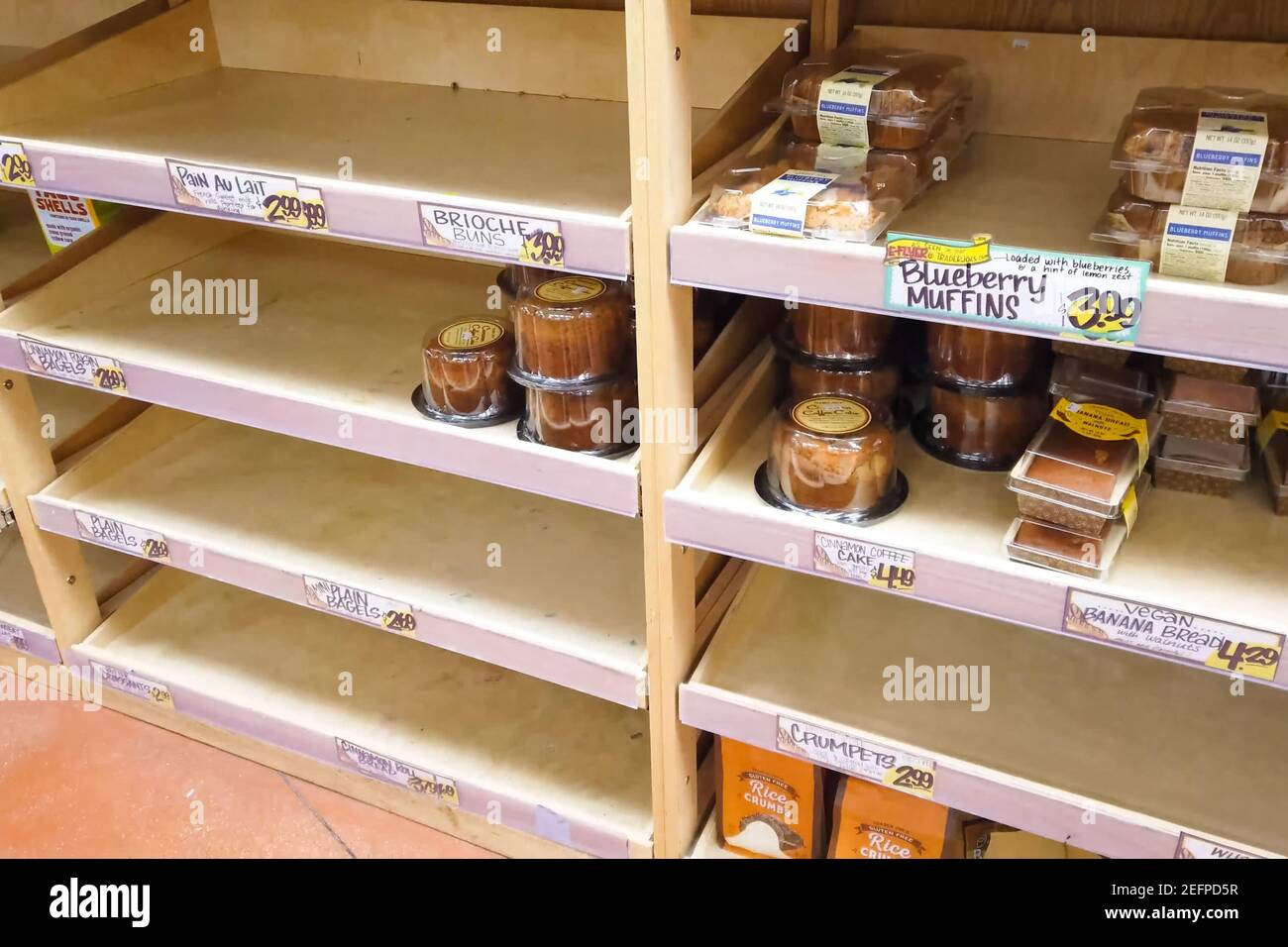 New York, USA - April 2, 2020: Empty shelves with groceries in supermarkets because of the panic from the coronavirus. Stock Photo