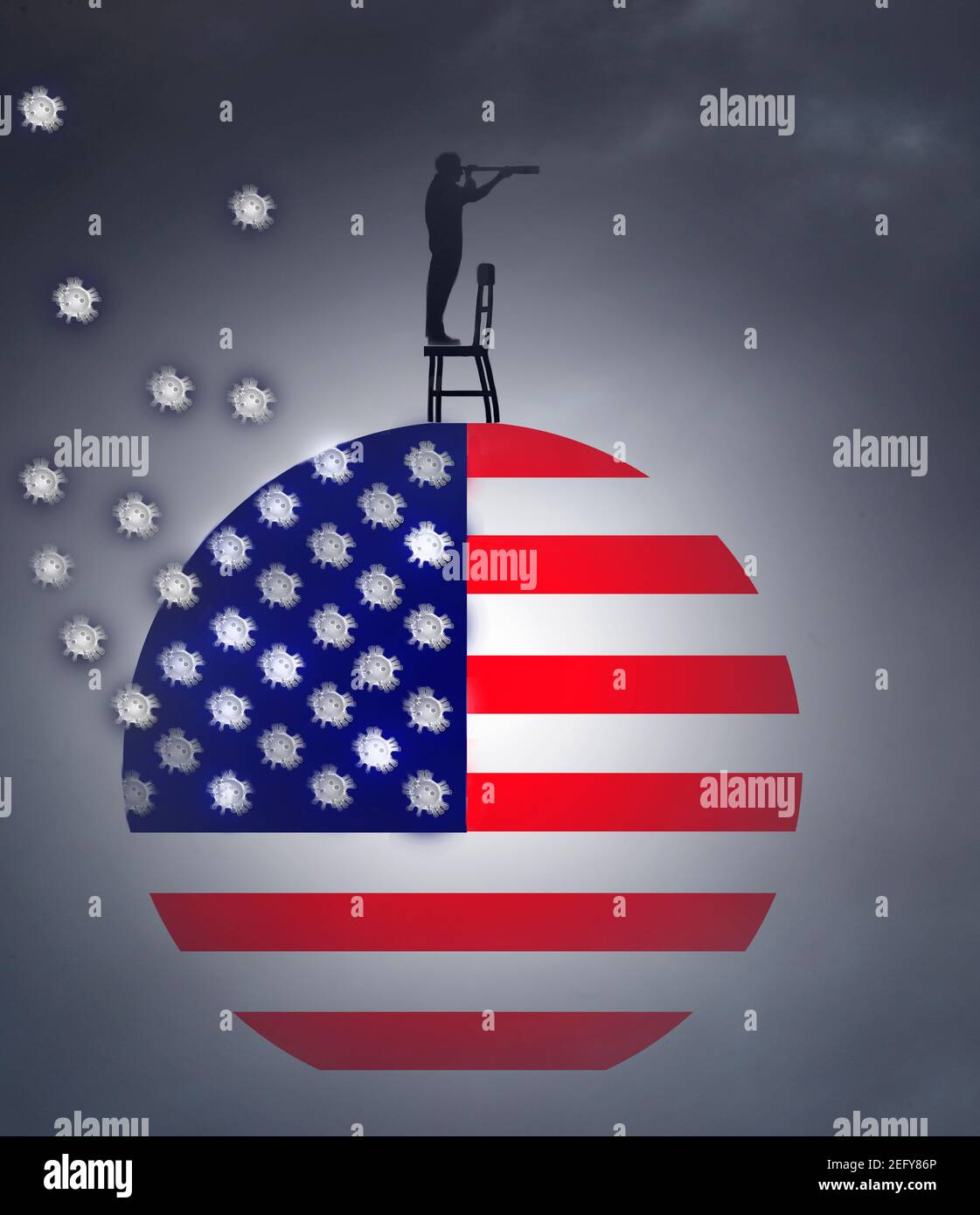 man standing on chair on American flag looking through a telescope with coronavirus behind Stock Photo