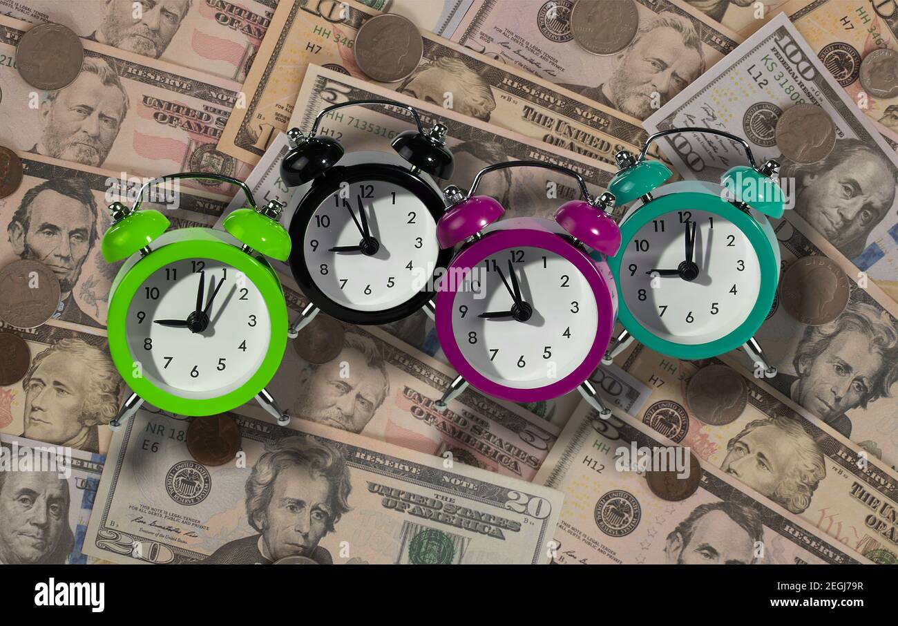Alarm clocks as a tax reminder symbol. The final date for payment of tax to the Tax Office. Stock Photo