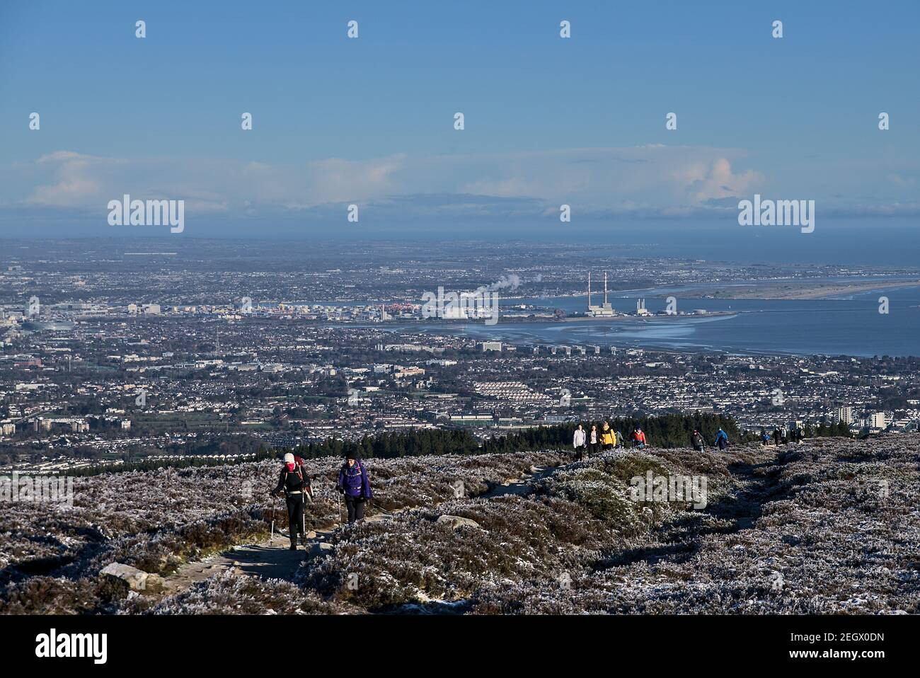 People hiking during coronavirus lockdown to see unusual Irish winter and landscapes of Dublin and Wicklow Mountains. Seen from Fairy Castle (Two Rock Stock Photo