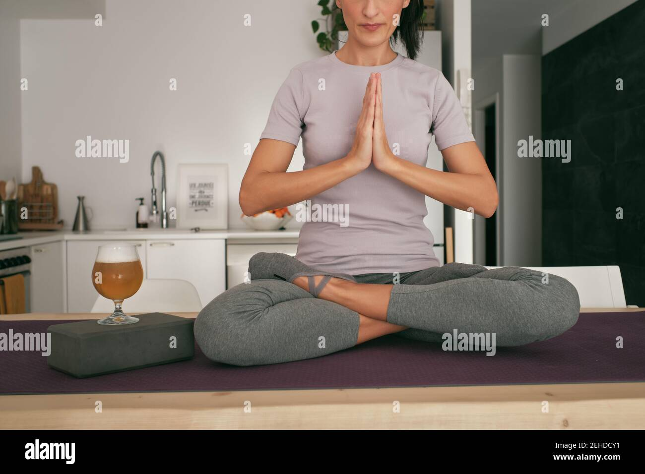 Cropped unrecognizable tranquil female sitting in Lotus pose on ...