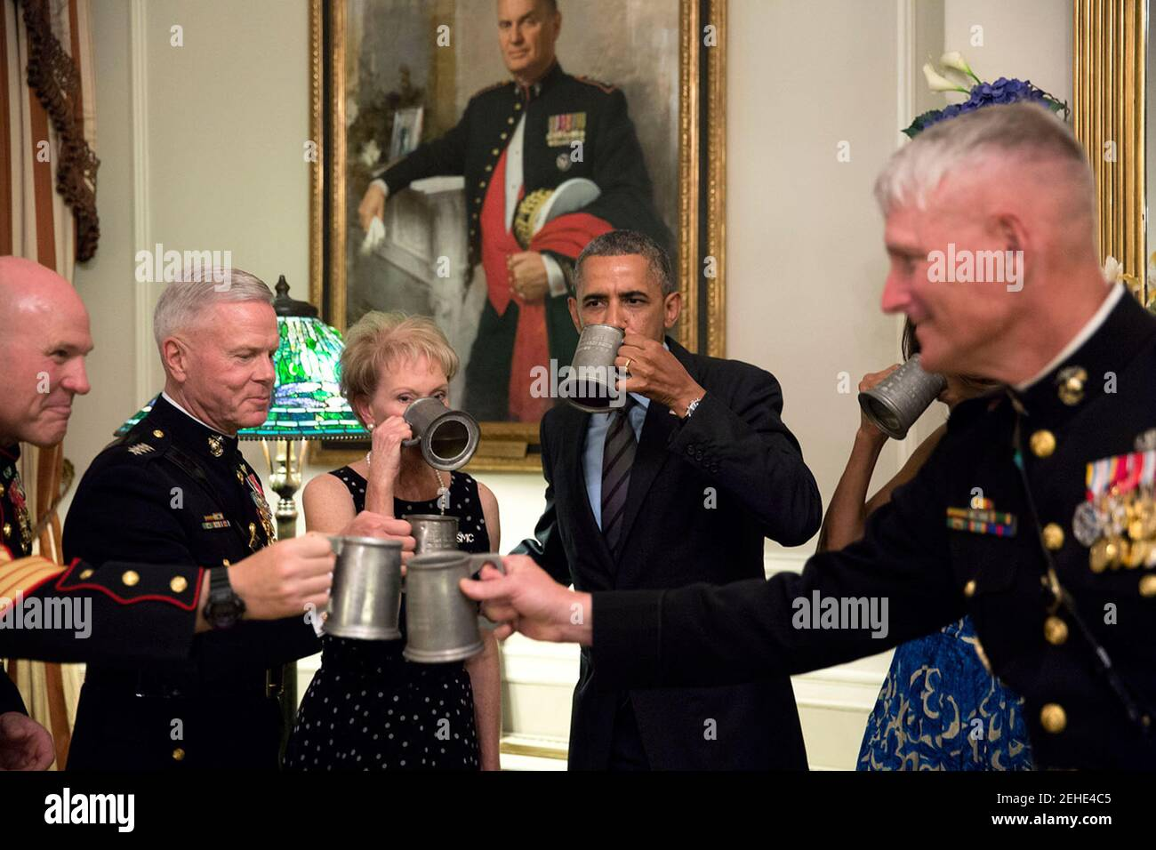 President Barack Obama and First Lady Michelle Obama join Gen. James Amos, Commandant of the Marine Corps, second left, and Mrs. Bonnie Amos for a celebratory toast at the Home of the Commandants at the Marine Barracks Washington in Washington, D.C, June 27, 2014. Stock Photo