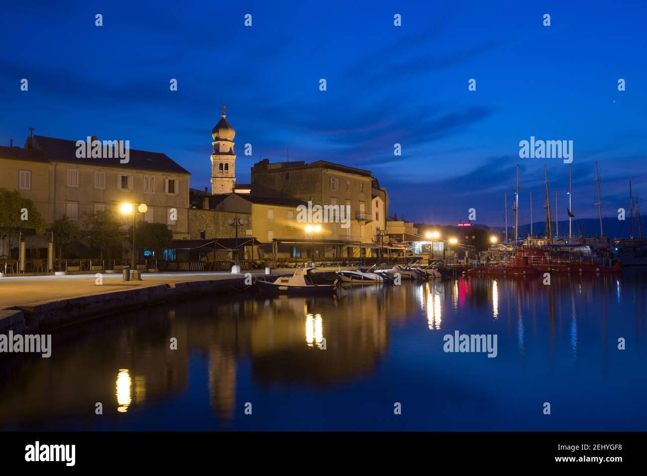 Night Photografy of City of Krks Empty Street next to a Boat Port Stock Photo