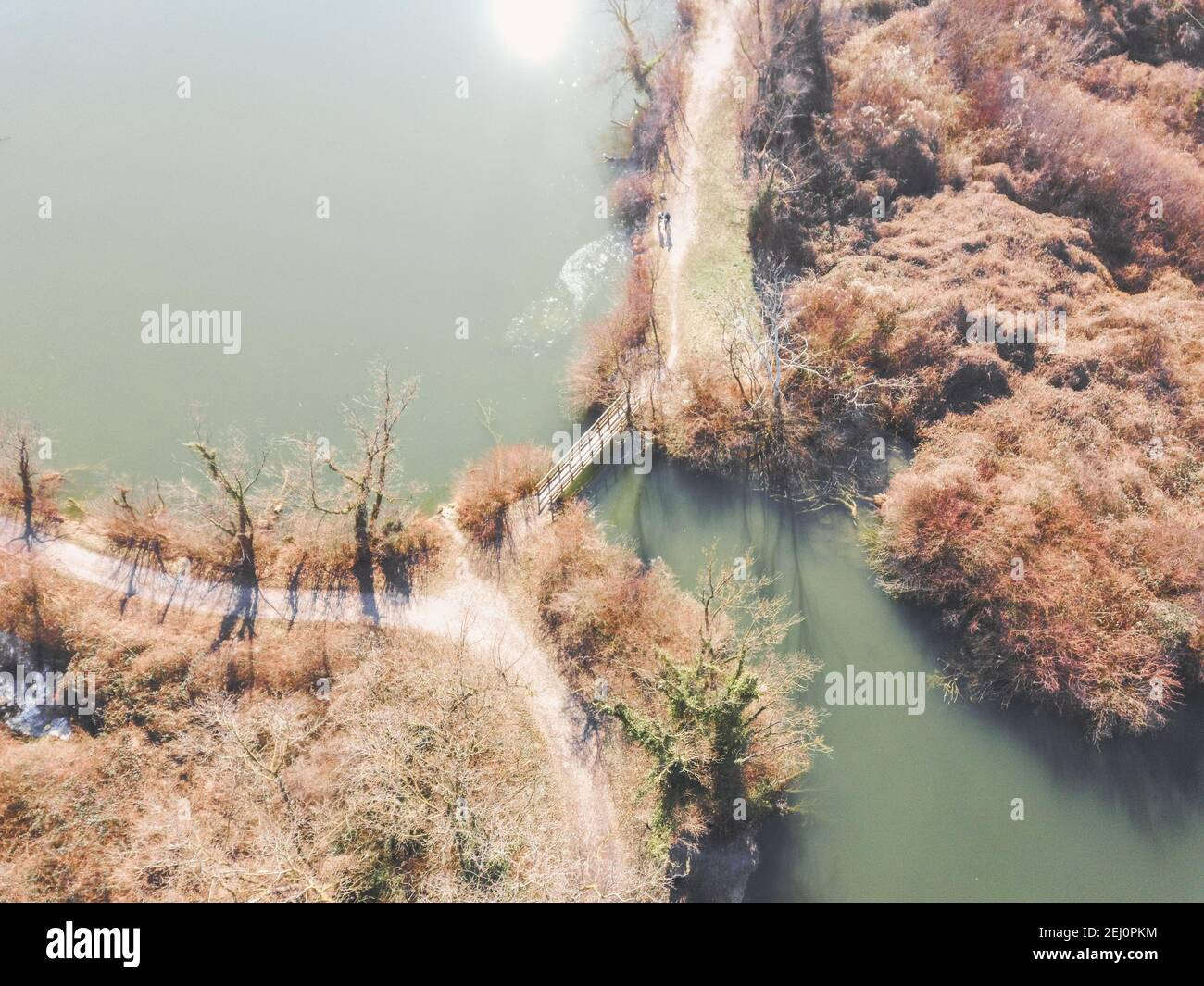 Aerial view of Savica fishing pond, located near eastern heating plant in Zagreb city, above secluded wooden bridge crossing water Stock Photo
