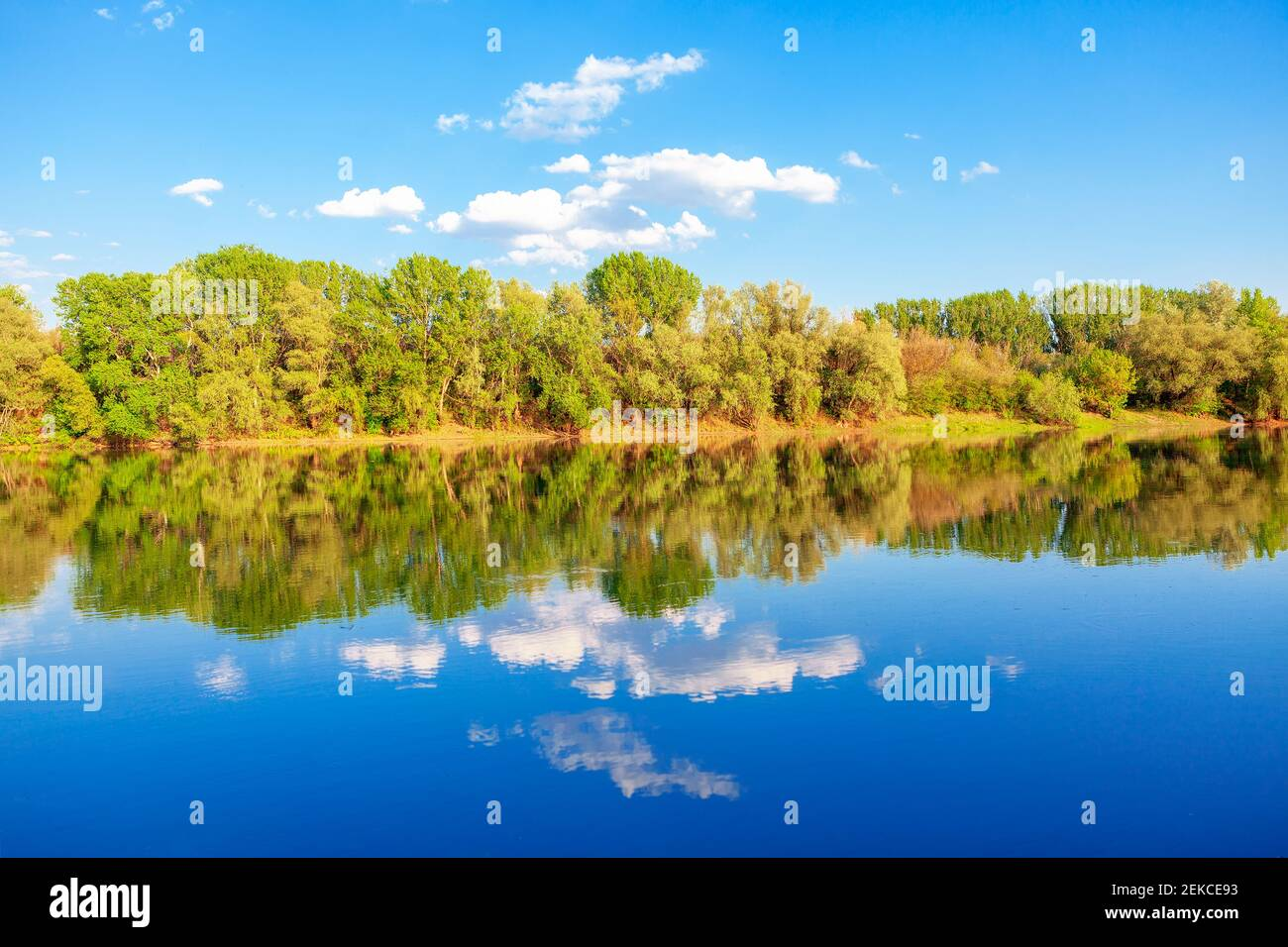Nature reflection in the lake water. Majestic spring scenery Stock Photo