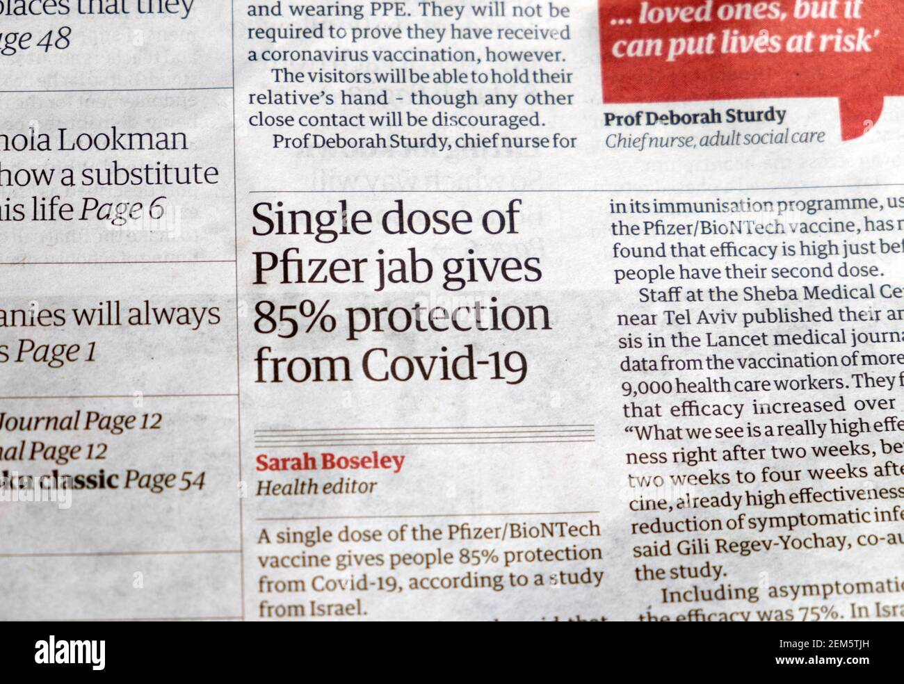 """""""Single dose of Pfizer jab gives 85% protection from Covid-19"""" Guardian newspaper headline on Covid article inside page 20 February 2021 London UK Stock Photo"""