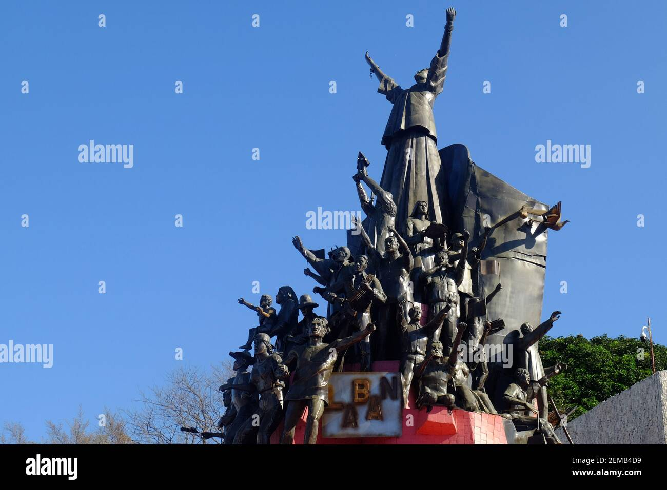 """Manila, Philippines. 25th Feb, 2021. The People Power Monument symbolizes how the people won over the dictator government of President Marcos last February 1986. Today is the 35th anniversary of EDSA revolution with its theme of """"EDSA 2021: Kapayapaan, Paghilom, Pagbangon (Peace, Healing, Recovery), to reflect on the national efforts in the face of COVID-19 pandemic. Credit: Majority World CIC/Alamy Live News Stock Photo"""