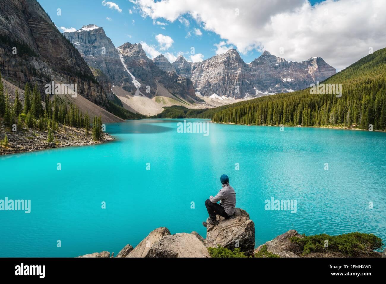 Hiker at Moraine Lake during summer in Banff National Park, Alberta, Canada. Stock Photo