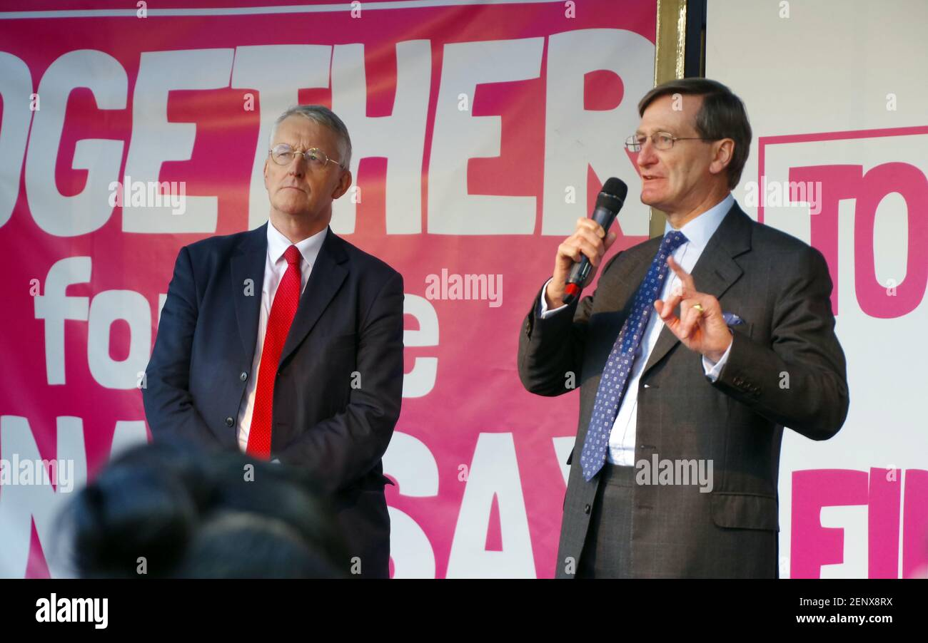 British barrister and former politician Dominic Grieve speaking at the third the People's Vote March, Parliament Square, London, UK on 19 October 2019. On the left is Hilary Benn, MP. Stock Photo