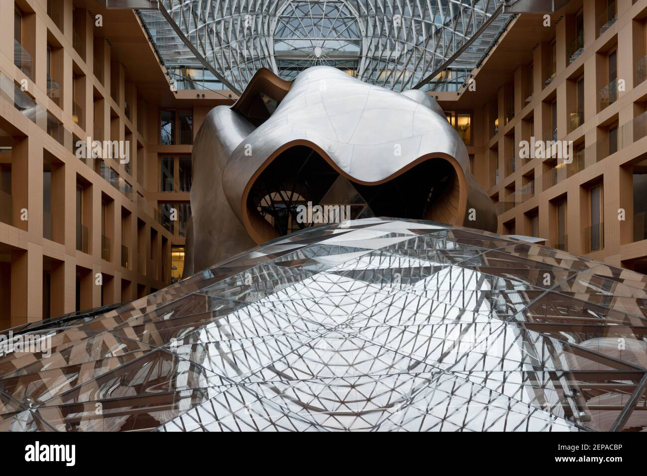 The glass and mesh atrium, designed by Frank Gehry, inside the DZ Bank building in Berlin, Germany. Stock Photo