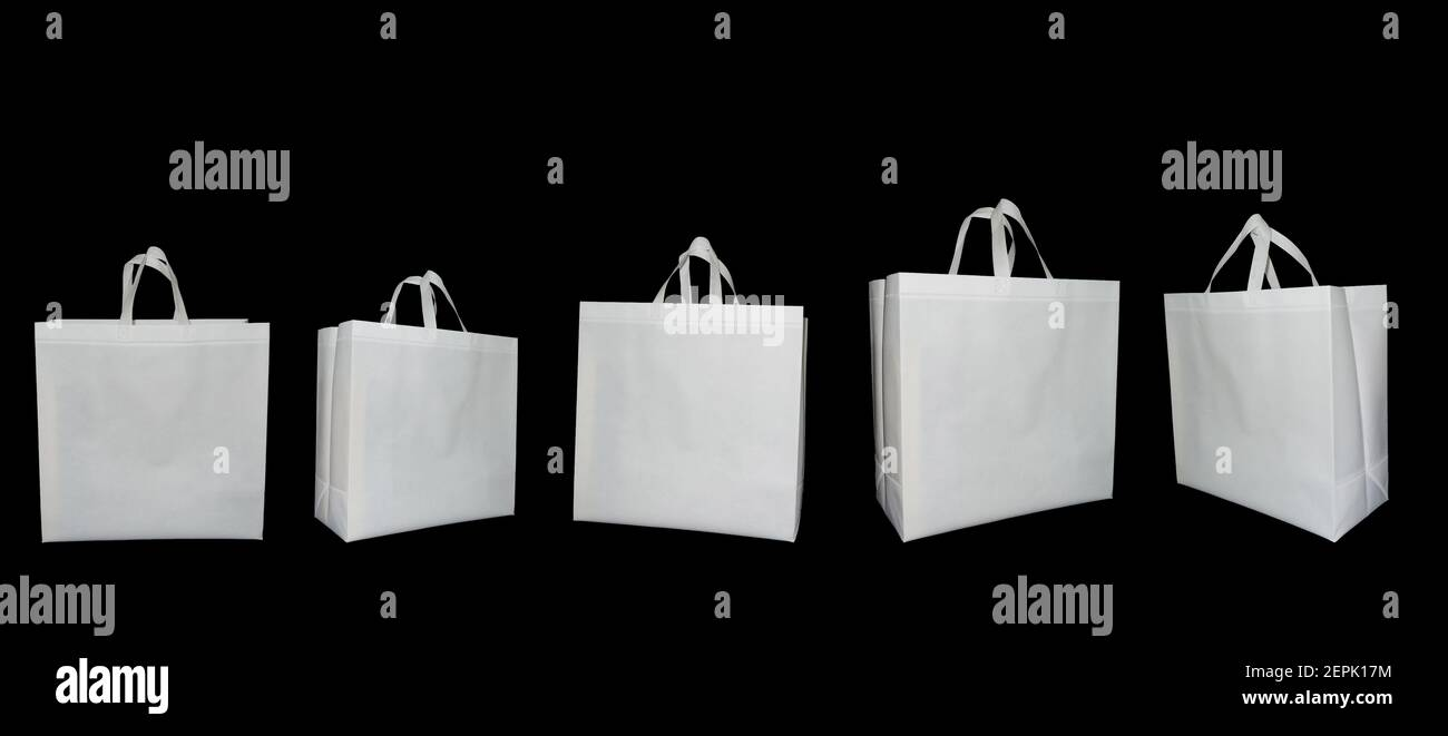 Set of Non Woven white Fabric handle loop Bags on black color Background. Non Woven ECO Friendly Shopping Bags. Biodegradable Bags. Mock-up Stock Photo