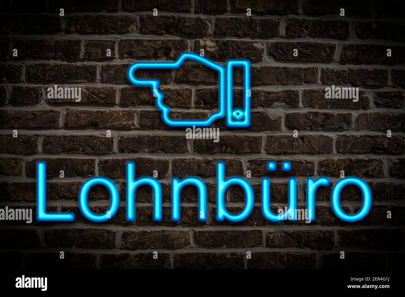 Detail photo of a neon sign on a wall with the inscription Lohnbüro (Payroll office) Stock Photo