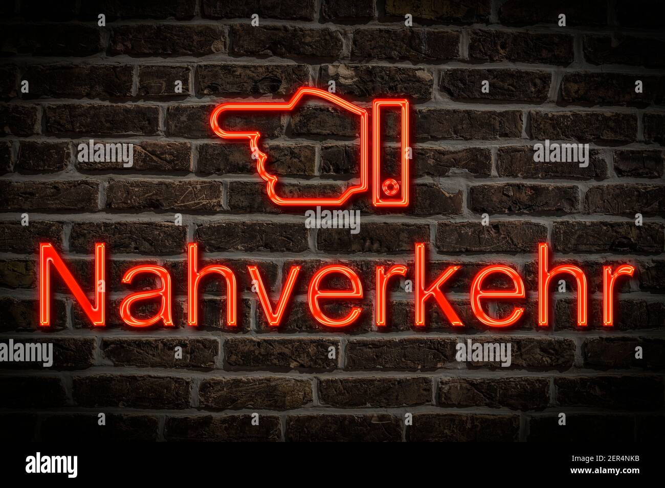 Detail photo of a neon sign on a wall with the inscription Nahverkehr (Local traffic) Stock Photo