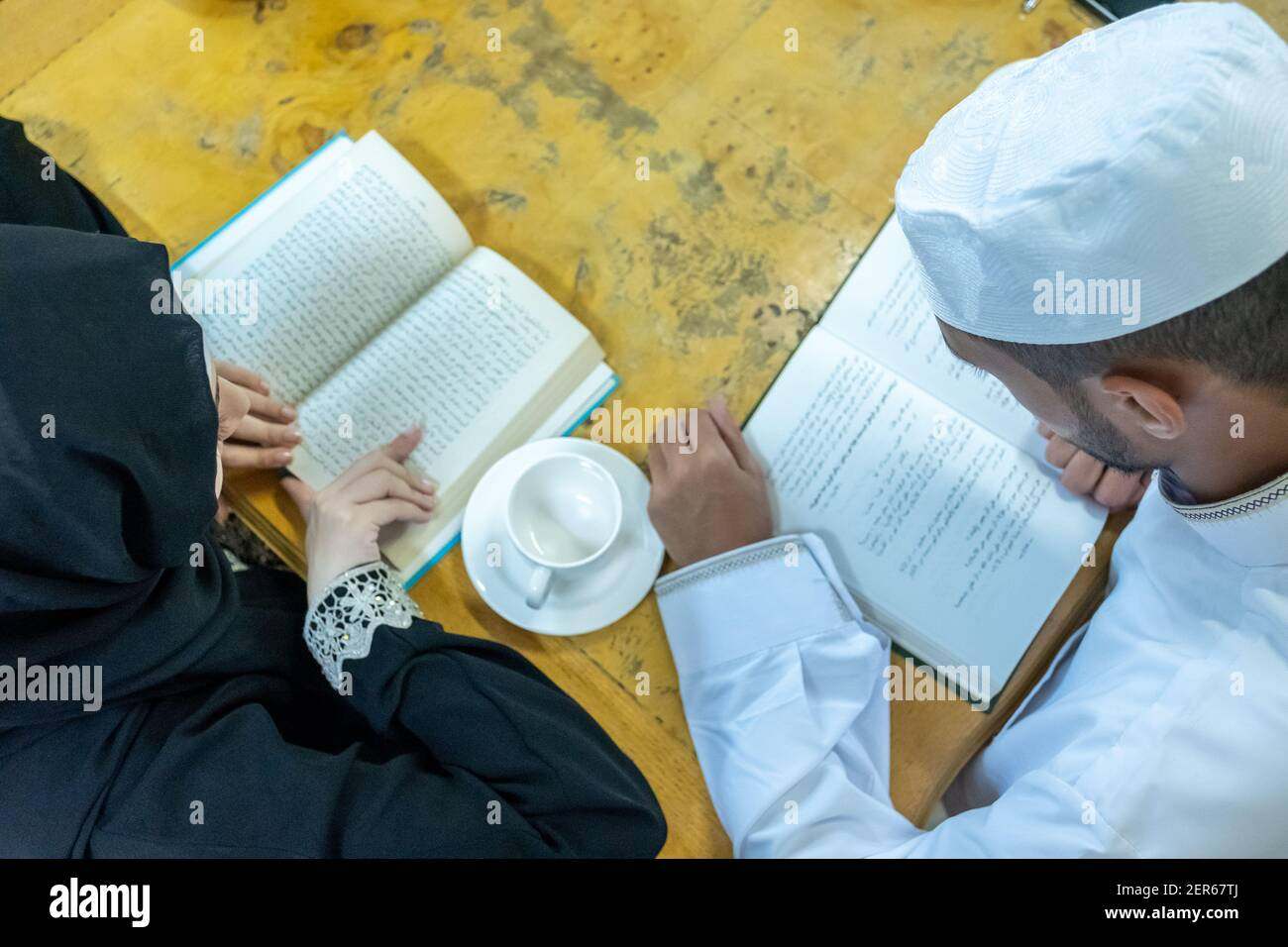 Arabic muslim people reading together and drnking some tea Stock Photo