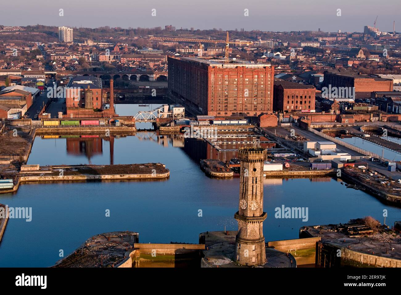 Tobacco Warehouse is a grade II listed building and is the world's largest brick warehouse. Constructed in 1901 standing 125 feet high in Stanley Dock Stock Photo