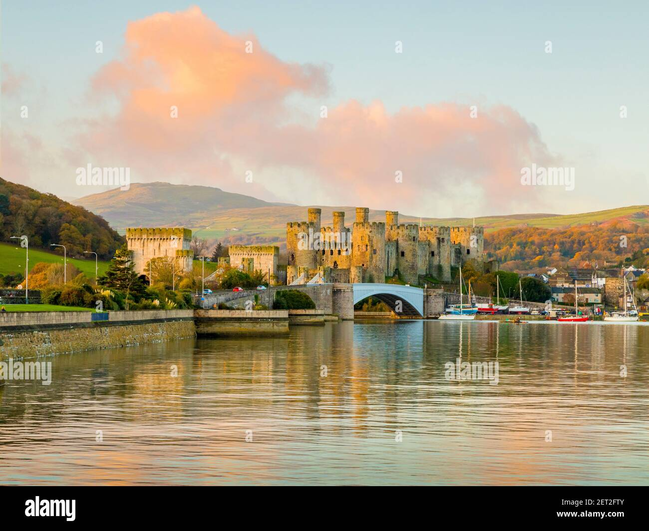 Conwy Castle, seen across the Conwy Estuary in North Wales. soon after sunrise. Stock Photo