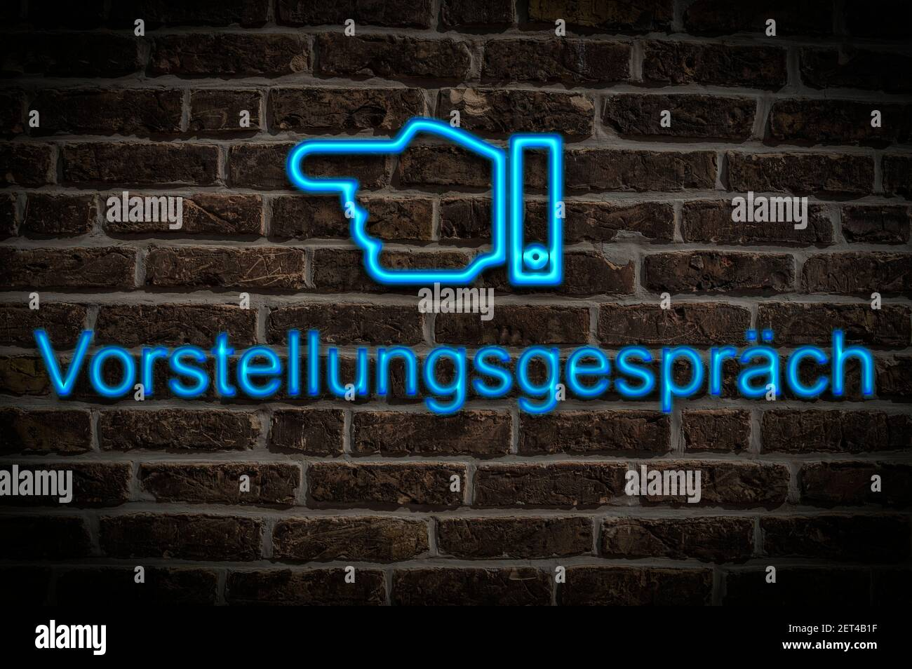 Detail photo of a neon sign on a wall with the inscription Vorstellungsgespräch (Job interview) Stock Photo