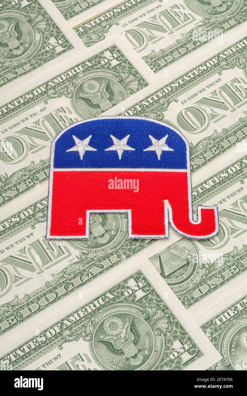 GOP Republican elephant logo patch badge with US $1 dollar banknotes. For US political fundraising & Republican campaign funds, small dollar donors. Stock Photo
