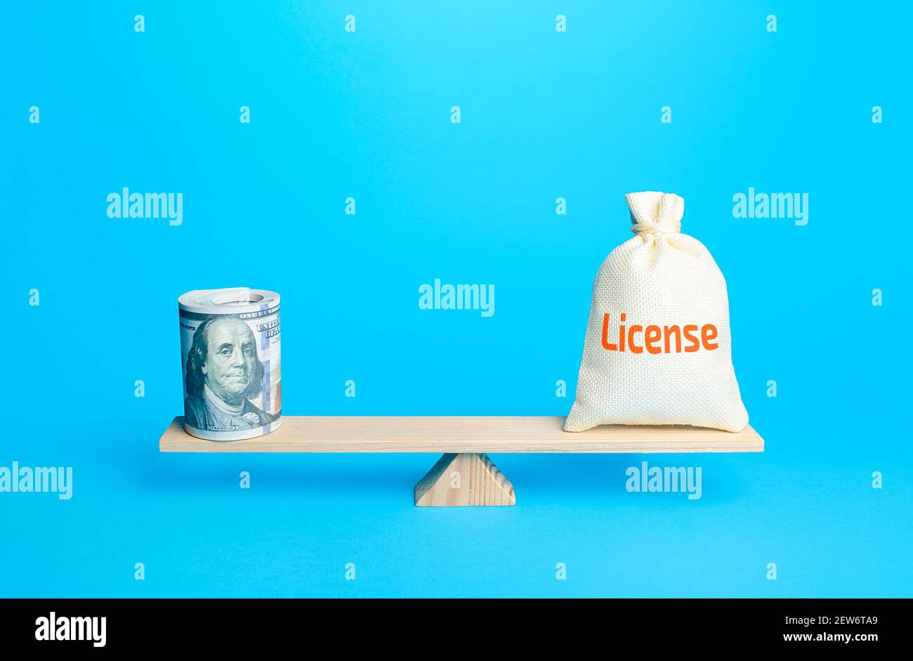 Dollars bundle and a bag with word License on scales. Estimating the value of copyrights and patents. Royalty deductions. Penalty for inconsistent use Stock Photo