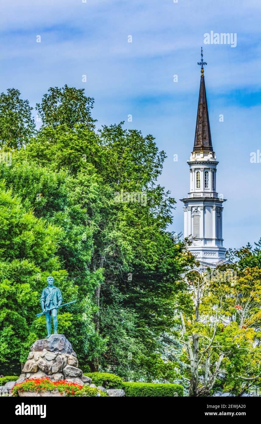 Lexington Minute Man Patriot Statue First Parish Church Spire Lexington Battle Green Massachusetts. Site of April 19, 1775 first battle of American Stock Photo