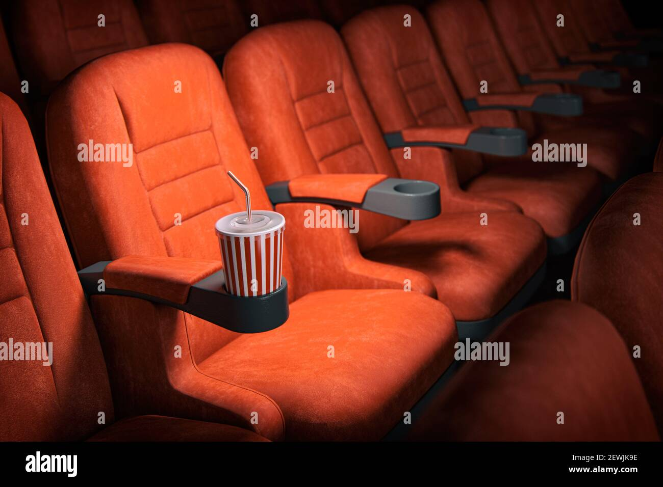 Cinema movie theater concept background. Red cinema seats and cola in empty theater. 3d illustration. Stock Photo