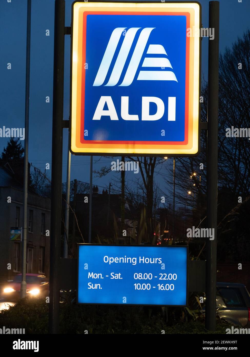 Illuminated Aldi sign in twilight at Westbury, Wiltshire, England, UK. Stock Photo