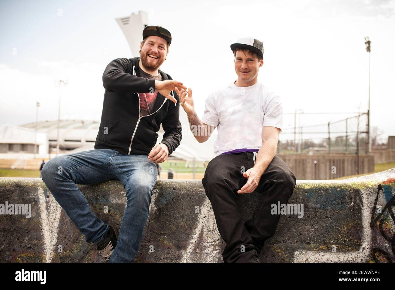 Two buddies bmxing and giving eachother a handshake Stock Photo