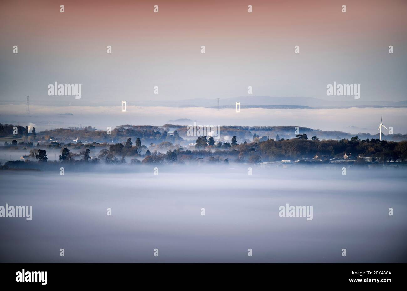 Misty views from the Cotswold Escarpment near Wotton-under-Edge in Gloucestershire looking towards the original Severn Bridge Stock Photo