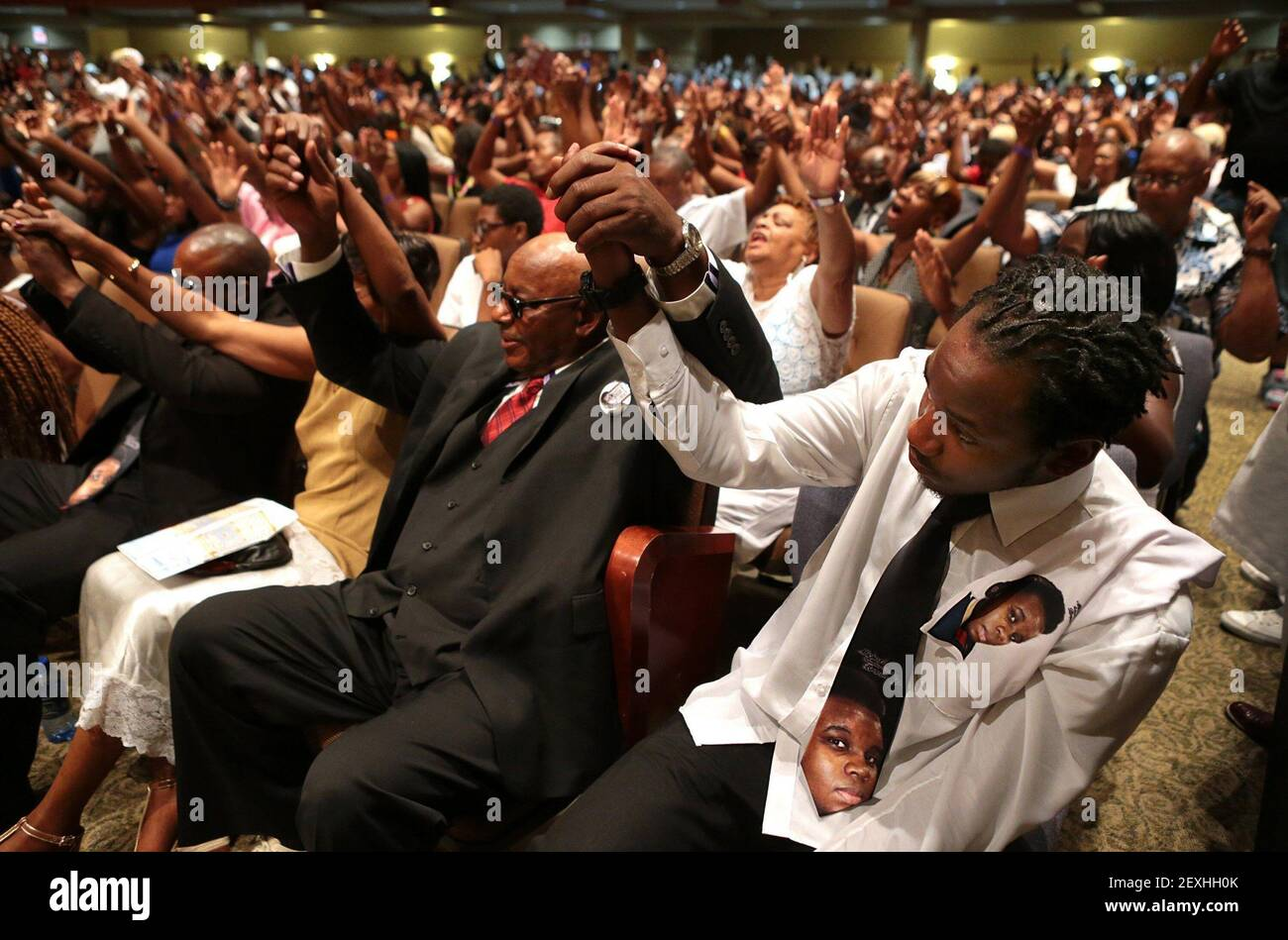 Leslie McSpadden, Jr., right, and his father Leslie McSpadden, Sr. raise their hands in prayer during the funeral for Michael Brown at Friendly Temple Missionary Baptist Church on Monday, Aug. 25, 2014. The men are the brother and father, respectively, of Michael Brown's mother Lesley McSpadden. (Photo by Robert Cohen/St. Louis Post-Dispatch/MCT/Sipa USA) Stock Photo