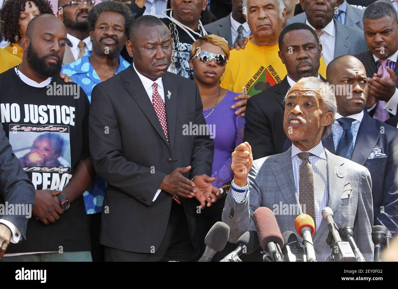 Rev. Al Sharpton addresses the media at a press conference about the shooting of Michael Brown on the steps of the Old Courthouse in St. Louis, Mo., on Tuesday, Aug. 12, 2014. Behind Sharpton, from left, is Michael Brown Sr., attorney Benjamin Crump, and Lesley McSpadden, Brown's mother. (Photo by J.B. Forbes/St. Louis Post-Dispatch/MCT/Sipa USA) Stock Photo