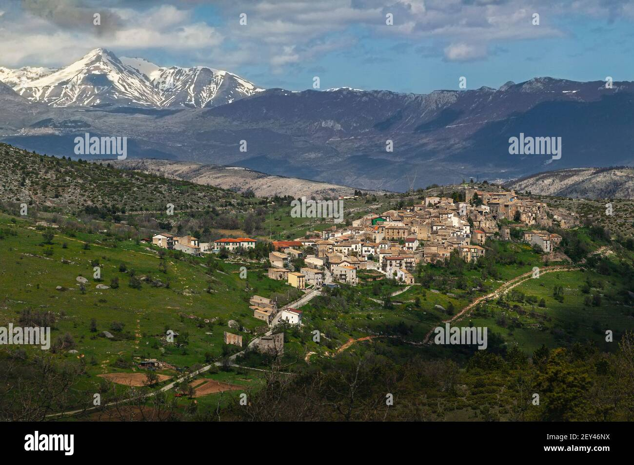 Aerial view of the medieval village of San Benedetto in Perillis. In the background, the Monte Camicia of the Gran Sasso mountain range. Abruzzo Stock Photo
