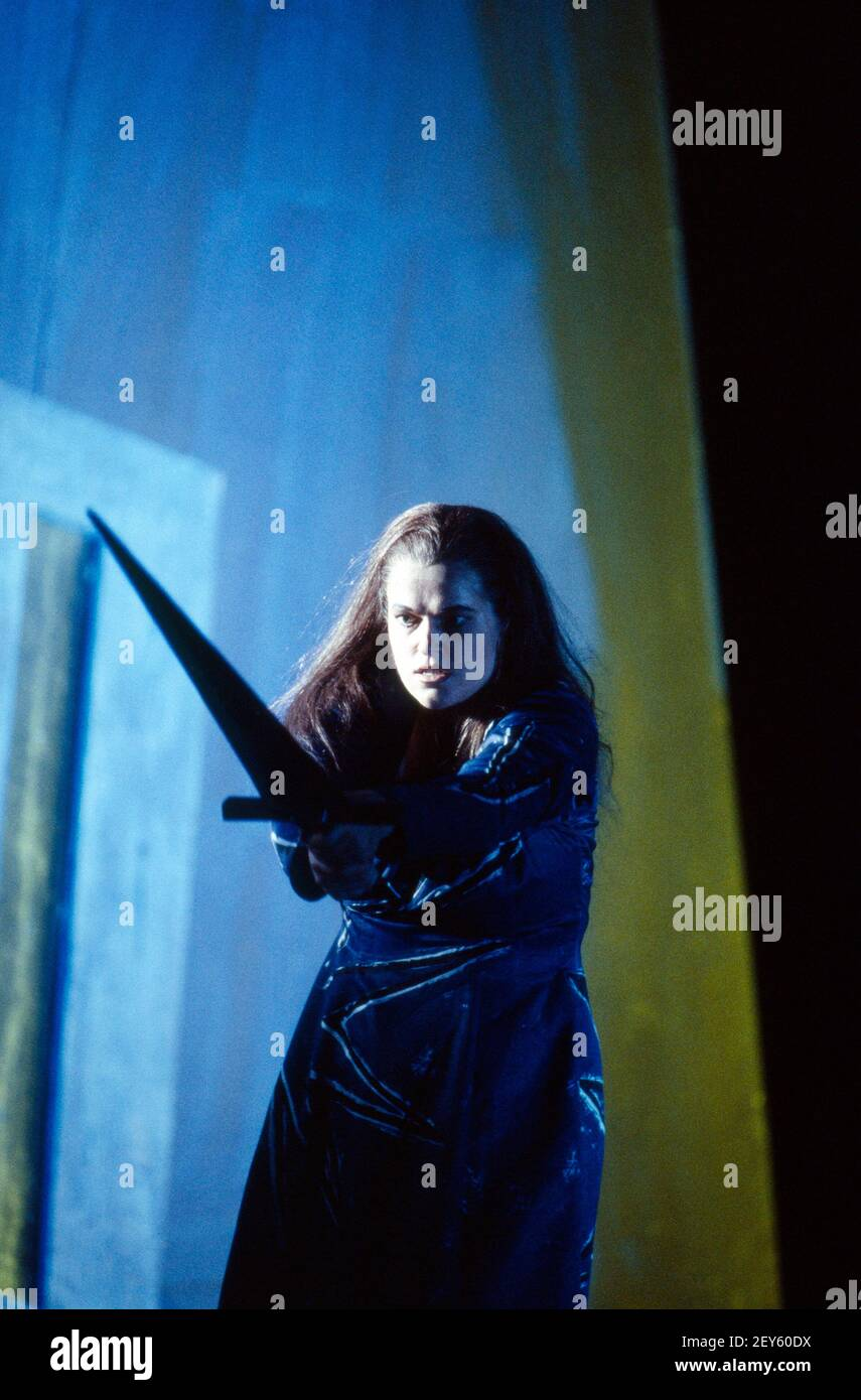 Ulla Gustafsson (Sieglinde) with Nothung in DIE WALKURE by Wagner at The Royal Opera, Covent Garden, London WC2  14/10/1994  conductor: Bernard Haitink  design: Nigel Lowery  lighting: Pat Collins  movement: Matthew Hamilton  director: Richard Jones Stock Photo