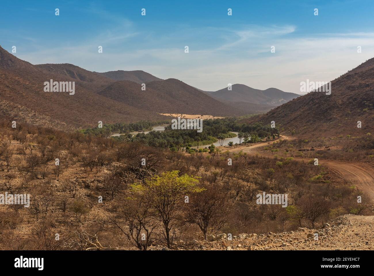 Landscape view of the Kunene River, the border river between Namibia and Angola Stock Photo
