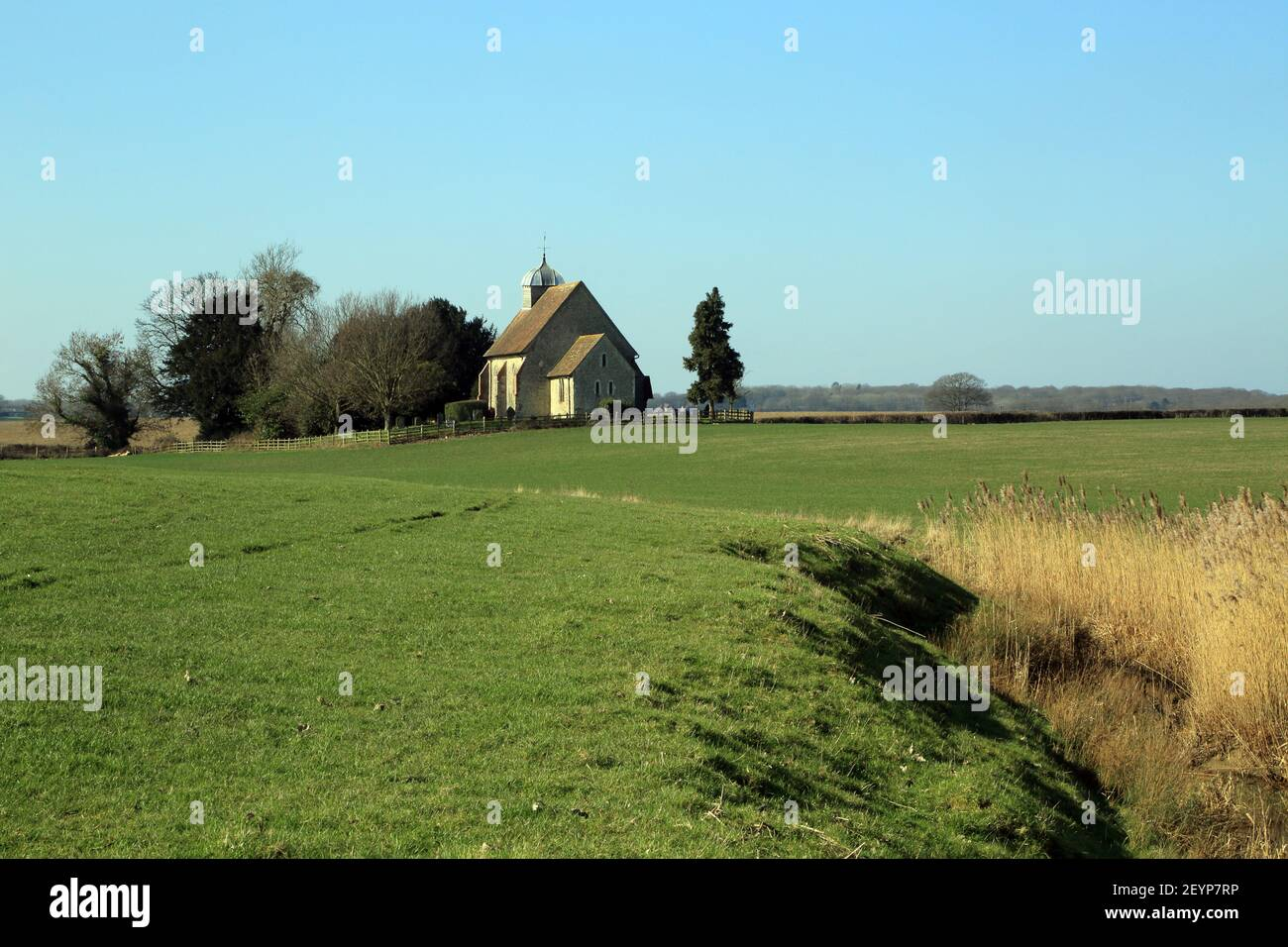 View of Saint Rumwold's church from the banks of the Royal Military Canal, Bonnington near Ashford in Kent, England, United  Kingdom Stock Photo