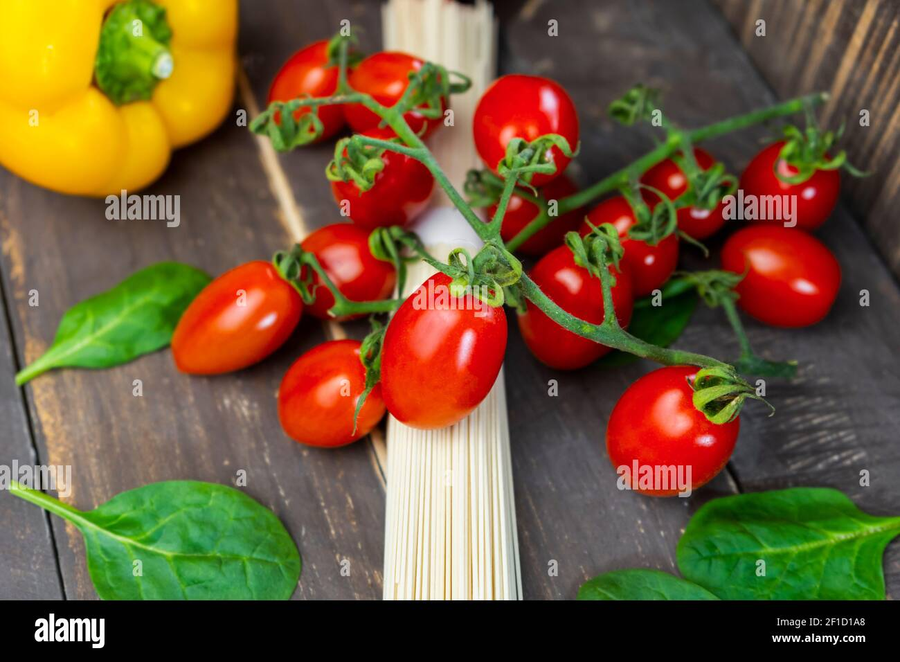 Fresh vegetables with spaghetti pasta on rustic wooden table.Closeup view of dieting food lifestyle ,healthy eating and italian food concept. Stock Photo