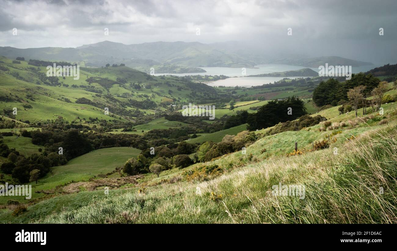 Storm approaching a valley with green rolling hills, storm approaching a valley with green rolling hills Stock Photo
