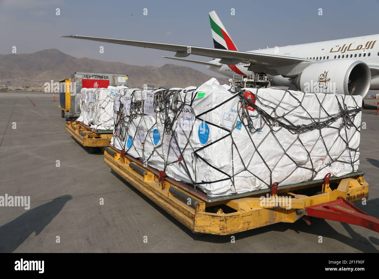 Kabul, Afghanistan. 8th Mar, 2021. Photo taken on March 8, 2021 shows COVID-19 vaccines from COVAX, an international program devised to help low and middle-income countries to have more access to COVID-19 vaccines, arriving at Hamid Karzai International Airport in Kabul, capital of Afghanistan. Credit: Sayed Mominzadah/Xinhua/Alamy Live News Stock Photo