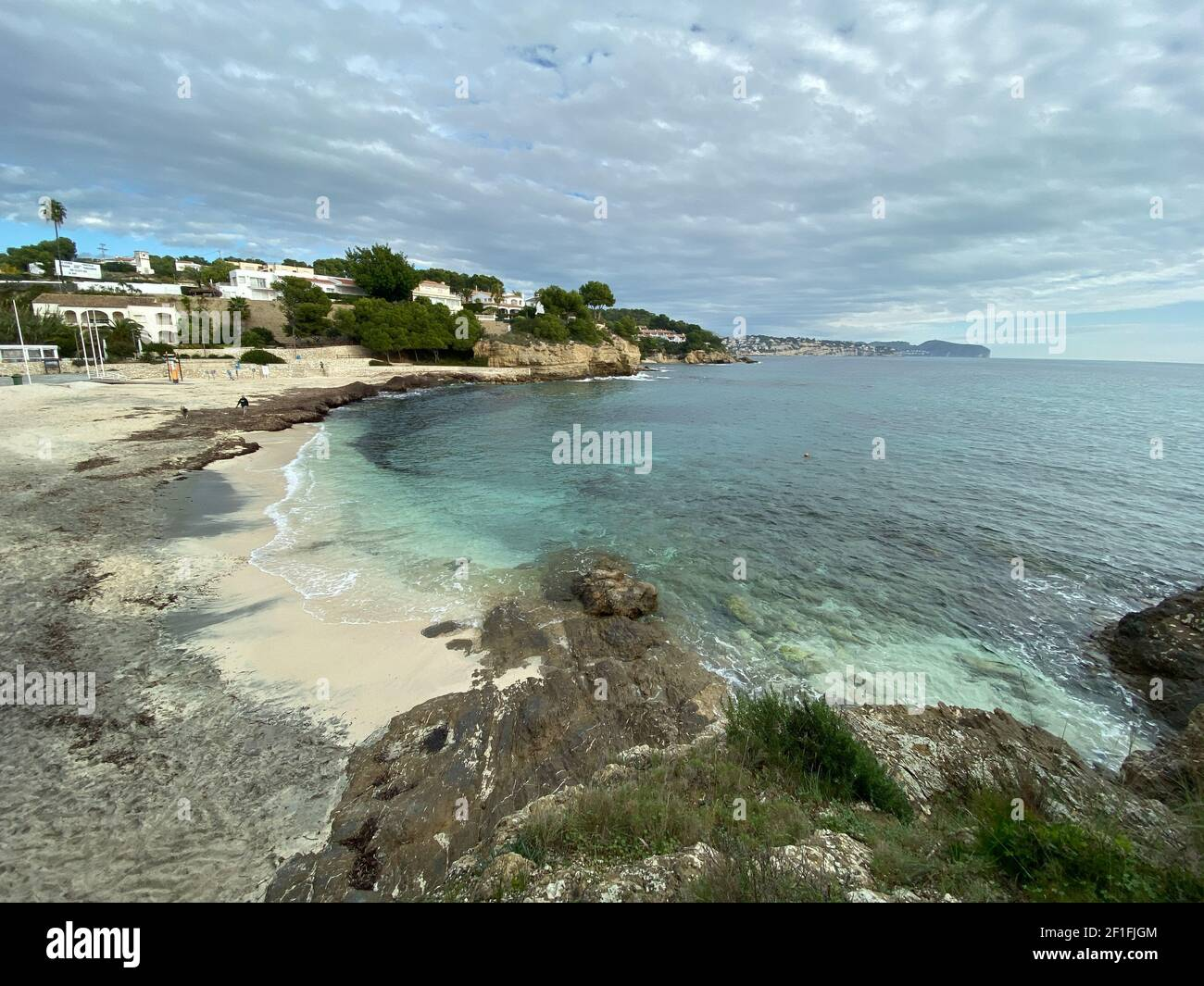 Sea waves lash line impact rock on the beach, located in Alicante, Spain, Stock Photo
