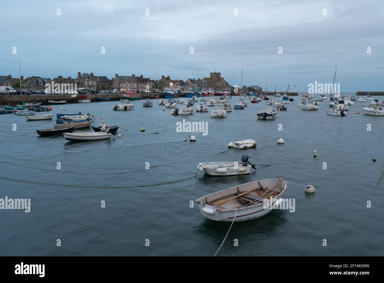 View of Barfleur and the harbor at low tide in the evening Stock Photo