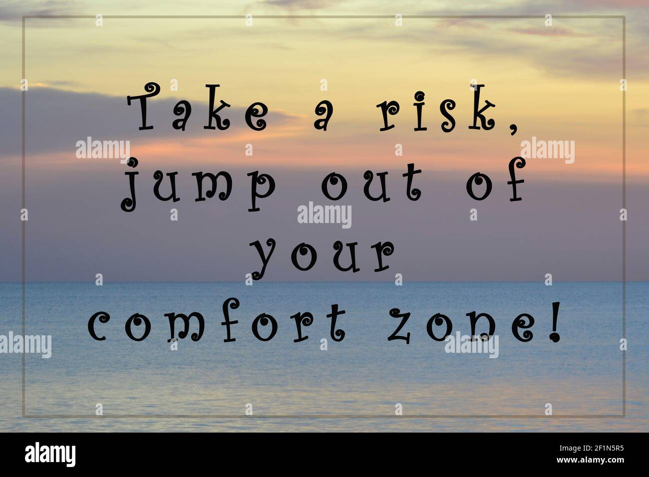 Blurred Image of sunset with motivational and inspirational quotes - Take a risk jump out of your comfort zone Stock Photo