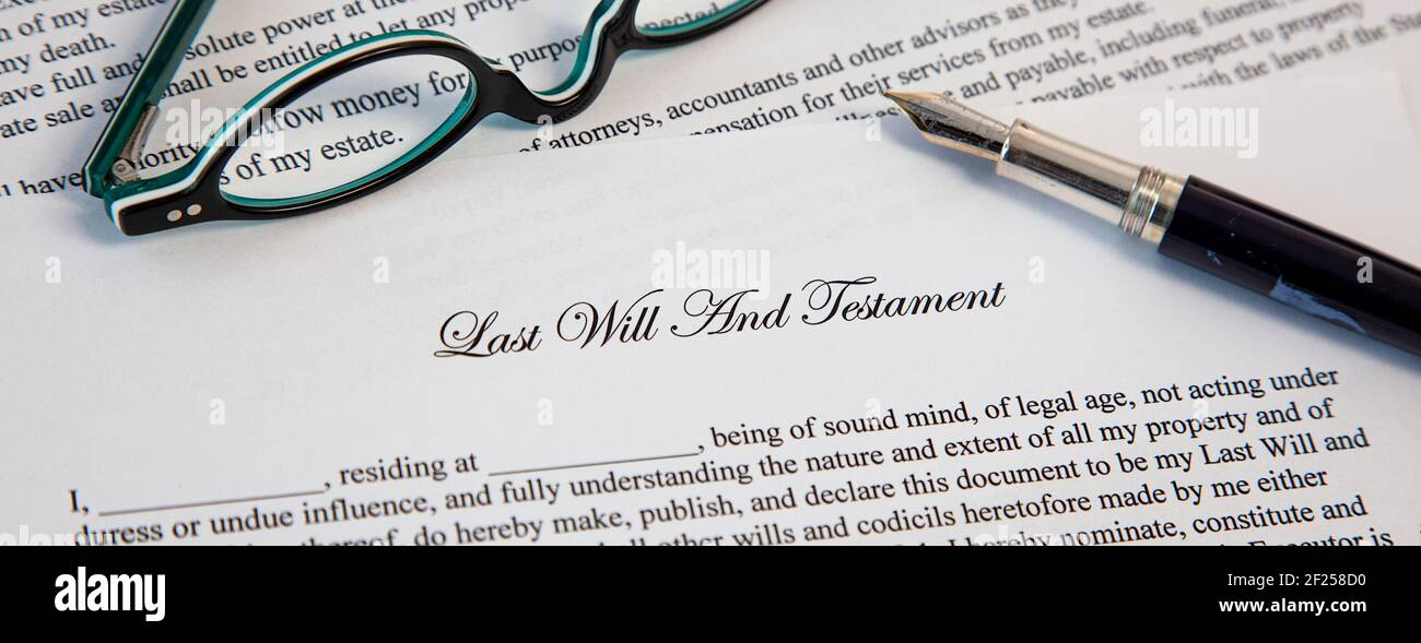Last Will And Testament Document With Fountain Pen and eyeglasses for Signing. Death And Inheritance Stock Photo
